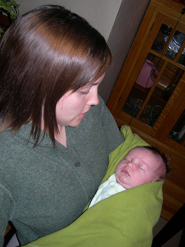 Photo of Erin Mendenhall holding her newborn baby in 2006