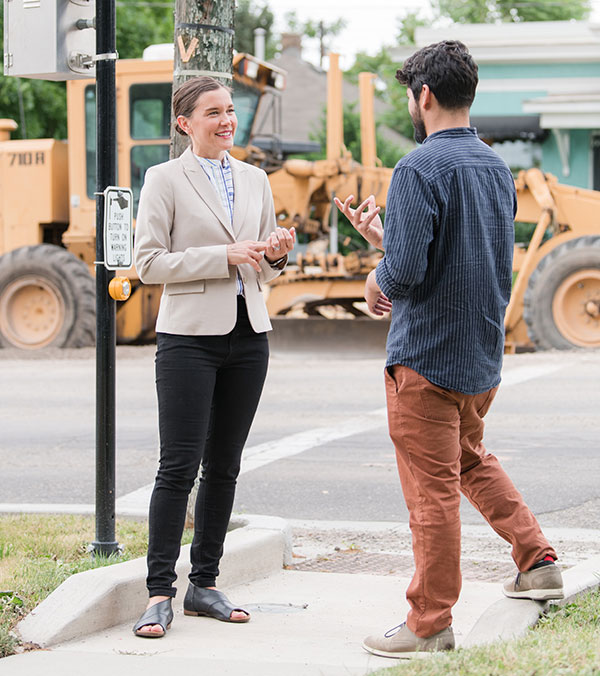 Photo of Erin at a road construction site