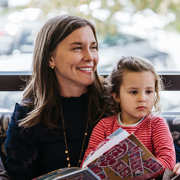 Photo of Erin reading with her daughter